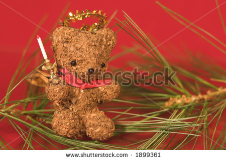 stock-photo-christmas-bear-angel-decoration-on-red-1899361